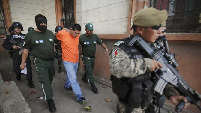 State police officers escort Martinez out of a court house in Veracruz
