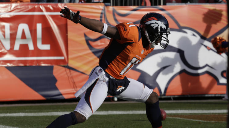 Denver Broncos wide receiver Trindon Holliday celebrates after running a punt return back 90 yards for a touchdown against the Baltimore Ravens in the first quarter of an AFC divisional playoff NFL football game, Saturday, Jan. 12, 2013, in Denver. (AP Photo/Joe Mahoney)