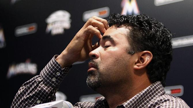 Miami Marlins manager Ozzie Guillen gestures at a news conference at Marlins Stadium in Miami, Tuesday April 10, 2012.  Guillen was suspended for five games Tuesday because of his comments about Fidel Castro. Guillen told Time magazine he loves Castro and respects the retired Cuban leader for staying in power so long. At least two local officials said Guillen should lose his job. (AP Photo/Lynne Sladky)