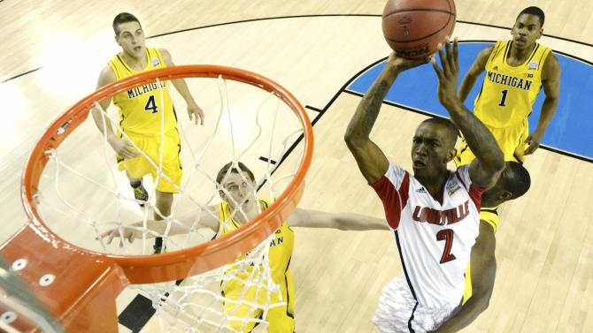 Louisville Smith scores against Michigan in the first half of their NCAA men's Final Four championship basketball game in Atlanta