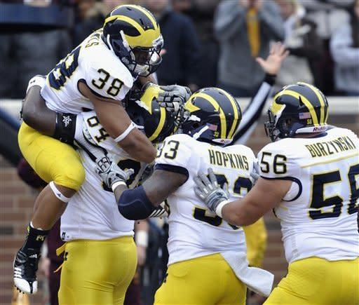Gardner sparks Michigan in 35-13 win at Minnesota