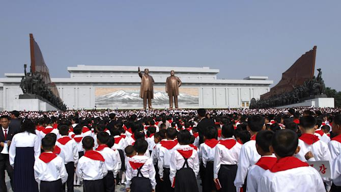 North Korean students who were selected as delegates to the Korean Children's Union, pay respects in front of bronze statues of late North Korean leaders Kim Il Sung and Kim Jong Il in Pyongyang, North Korea, Sunday, June 3, 2012. Primary school students from around the nation selected as delegates to the Korean Children's Union are taking part in celebrations to mark the June 6 anniversary of the political organization. The children's festival is expected to include visits to amusement parks, zoos and other landmarks in Pyongyang. (AP Photo/Jon Chol Jin)