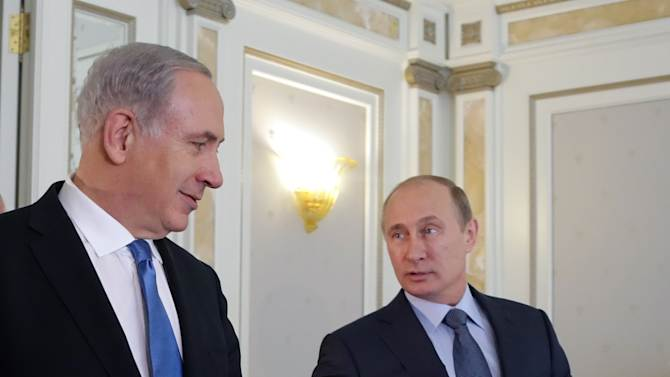 Russian President Vladimir Putin, right, welcomes Israeli Prime Minister Benjamin Netanyahu during their meeting at the Bocharov Ruchei residence in the Black Sea resort of Sochi, Russia, Tuesday, May 14, 2013.  Putin hosting Netanyahu for talks focusing on the situation in Syria, amid concerns that Moscow could soon provide Damascus with advanced missiles. (AP Photo/ Maxim Shipenkov, pool)