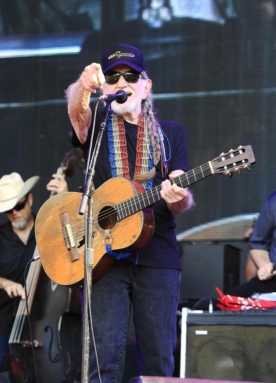 Willie Nelson performs at the Oklahoma Twister Relief Concert at the Gaylord Family-Oklahoma Memorial Stadium on Saturday, July 6, 2013 in Norman, Okla. (Photo by Alonzo Adams/Invision/AP)