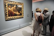 "Visitors look at the painting ""Sacrifice of Isaac"" by Italian artist Michelangelo Merisi known as Caravaggio, in June 2012 at the Fabre Museum in Montpellier, France. Italian art experts have reportedly discovered around 100 drawings and a number of paintings by the young Renaissance master Caravaggio in a find that could be worth up to 700 million euros"