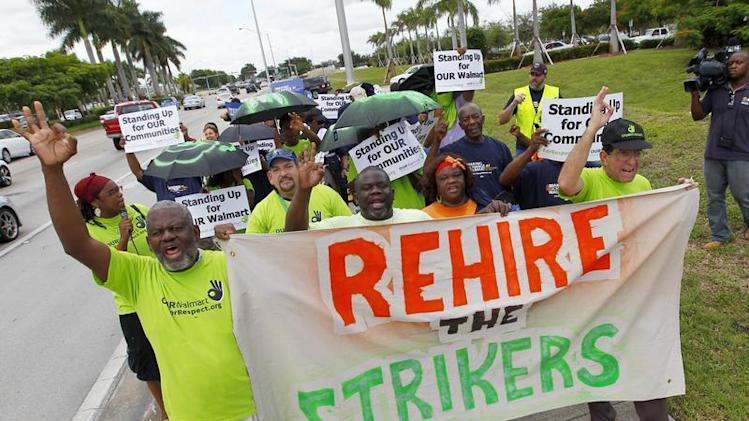 Walmart workers and supporters protest low wages outside one of the company's stores in Miami Gardens