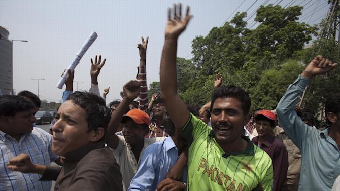 Pakistan's cricket fans trying to enter in the Gaddafi stadium in Lahore, Pakistan, Friday, May 22, 2015. Zimbabwe is the first test playing nation to visit Pakistan in more than six years since gunmen attacked a bus of the Sri Lanka's team in Lahore in 2009. (AP Photo/B.K. Bangash)