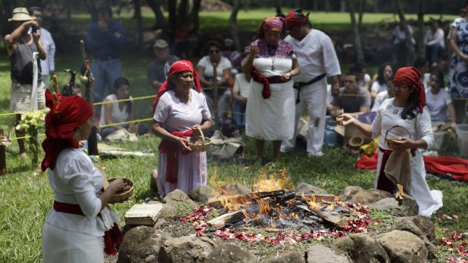 Members of the Mayan priest council pray during an ancient Mayan ceremony to celebrate the Autumnal equinox in the northern hemisphere at the Cihutan Archeological site in the town of Aguilares