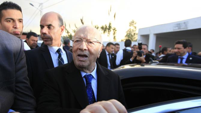 Essebsi, leader of Tunisia's secular Nidaa Tounes party and a presidential candidate, leaves after casting his vote at a polling station in Tunis