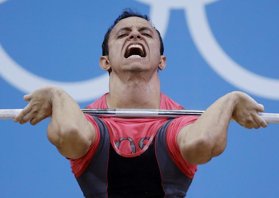 Ahmed Saad of Egypt competes during the mens 62-kg weightlifting competition at the 2012 Summer Olympics, Monday, July 30, 2012, in London. (AP Photo/Mike Groll)