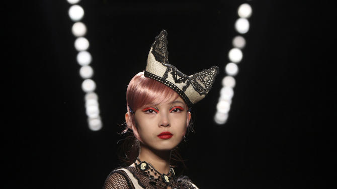 A model wears a design from Anna Sui's Spring 2013 collection during Fashion Week in New York, Wednesday, Sept. 12, 2012.  (AP Photo/Seth Wenig)