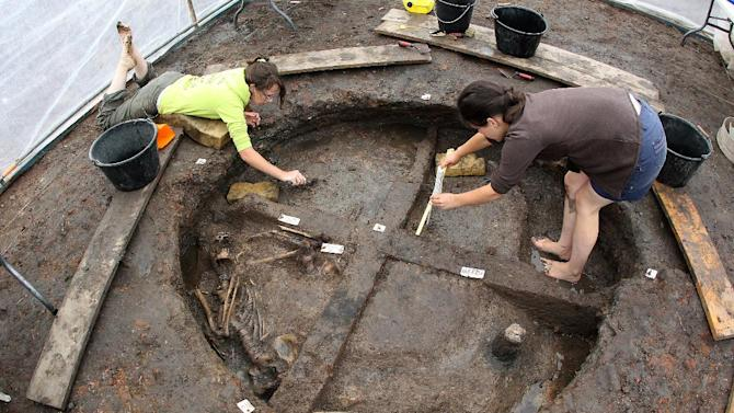 Researchers exhume human remains dating back to abuot - 500 BC during excavation works on August 14, 2014 in eastern France