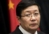 Chinese Minister of Finance Lou Jiwei pauses while speaking during a briefing at the US Department of the Treasury July 11, 2013 in Washington, DC. The United States and China said Thursday they had moved forward on a treaty that would ramp up investment as the world's two largest economies highlighted progress in often strained ties