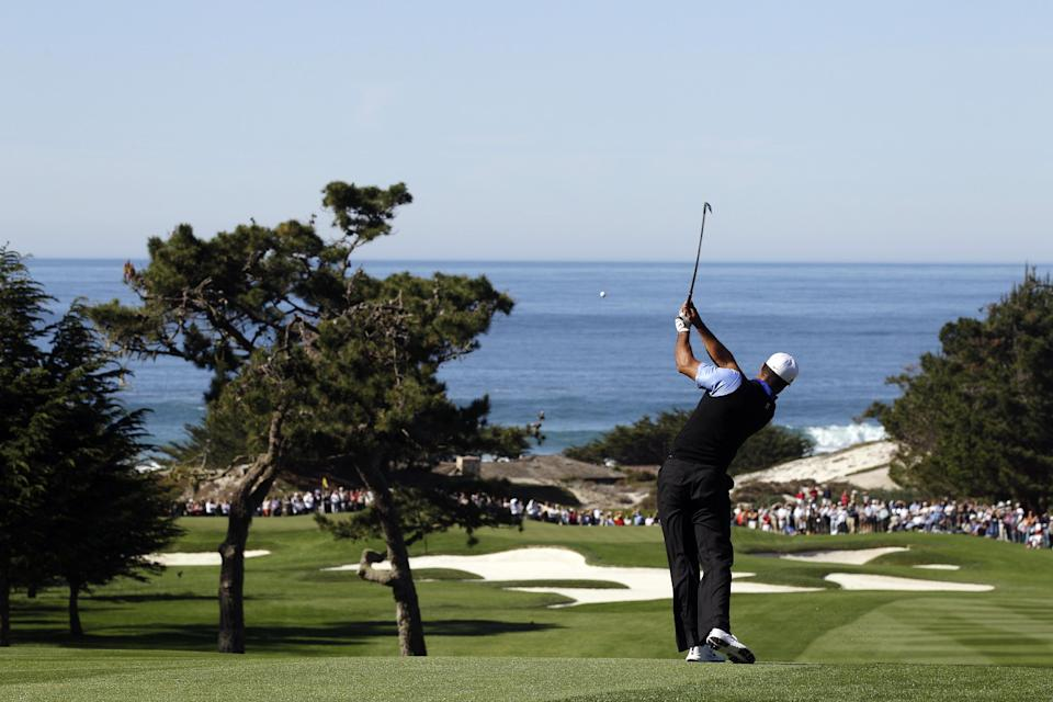Tiger Woods hits from the first fairway at Spyglass Hill Golf Course during the first round of the Pebble Beach National Pro-Am golf tournament in Pebble Beach, Calif., Thursday, Feb. 9, 2012. (AP Photo/Marcio Jose Sanchez)
