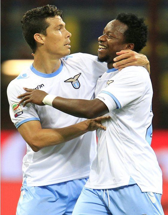 Lazio's Onazi celebrates with team mate Hernanes after scoring third goal against Inter Milan during their Italian Serie A soccer match in Milan