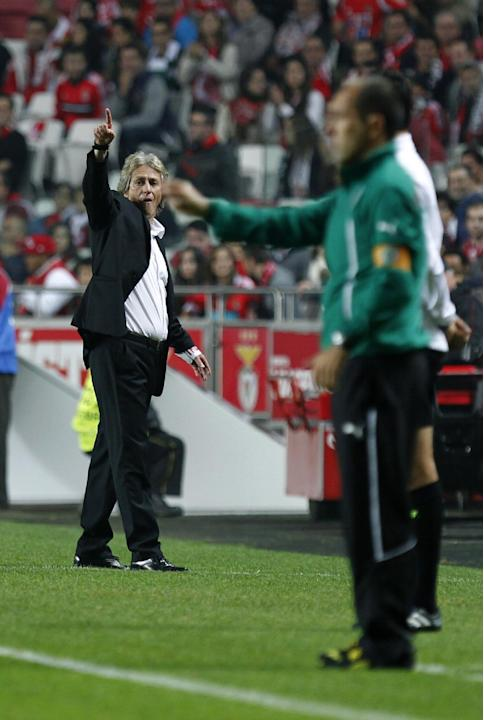 Benfica's coach Jorge Jesus, left, and Sporting's coach Leonardo Jardim, right, give instructions to their players during a Portugal Cup soccer match between Benfica and Sporting at Benfica's Luz stad