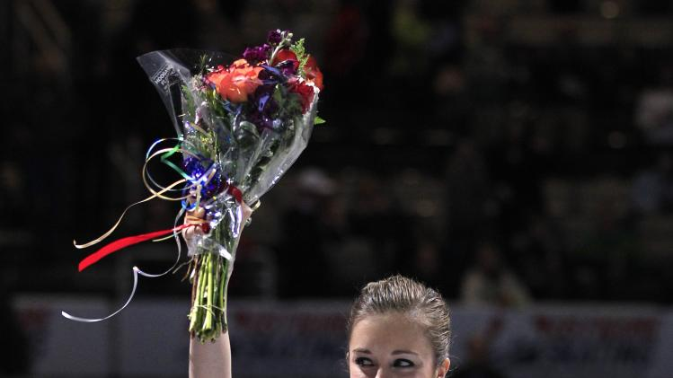 Ashley Wagner salutes the crowd after winning the ladies free skate event at the U.S. Figure Skating Championships in San Jose, Calif., Saturday, Jan. 28, 2012. (AP Photo/Marcio Jose Sanchez)