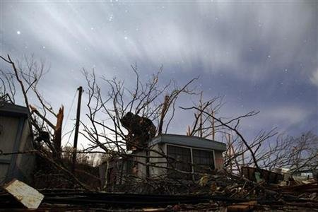 A damaged home is seen in the wake of a tornado at West Liberty
