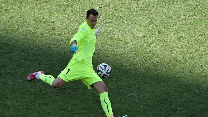 Switzerland's goalkeeper Diego Benaglio clears the ball in the second half of extra time during a Round of 16 football match between Argentina and Switzerland at Corinthians Arena in Sao Paulo during the 2014 FIFA World Cup on July 1, 2014