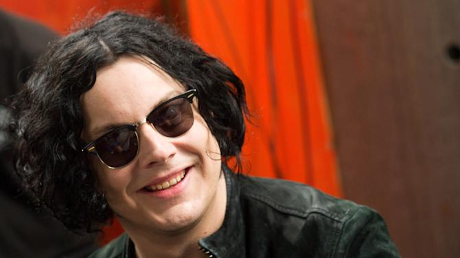 """FILE - In this June 24, 2011 file photo, Jack White signs copies of the record he made with Stephen Colbert in New York. The former White Stripe has released his first solo album, """"Blunderbuss."""" (AP Photo/Charles Sykes, File)"""