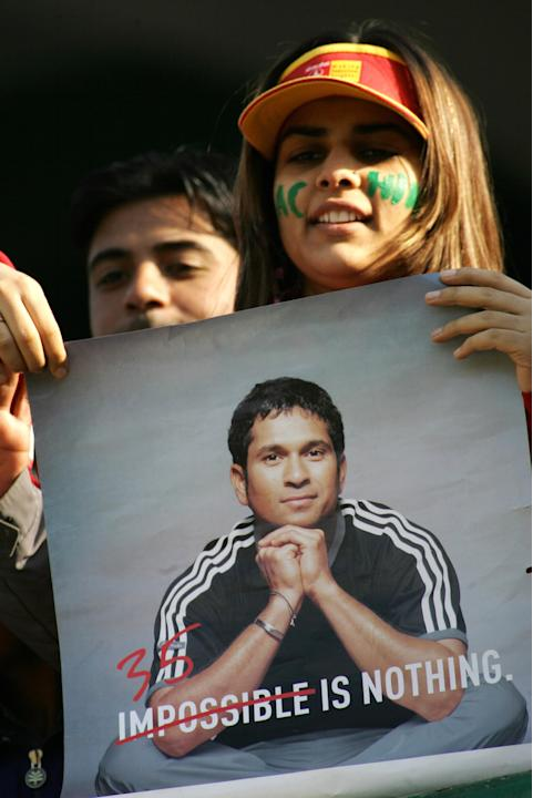 An Indian supporter holds a poster of In