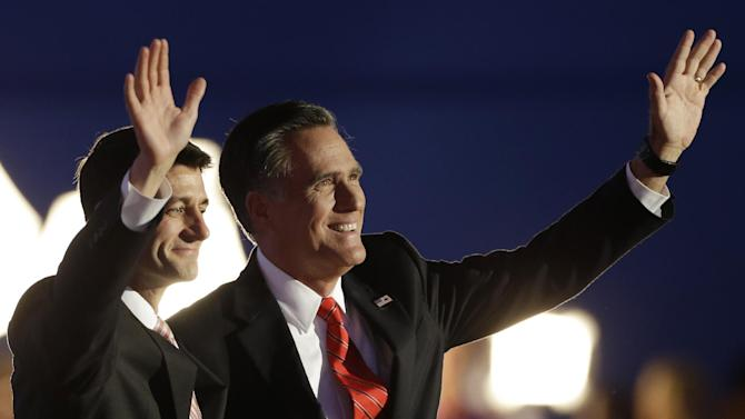 Republican presidential nominee Mitt Romney and Republican vice presidential nominee, Rep. Paul Ryan, left, wave following Romney's speech during the Republican National Convention in Tampa, Fla., on Thursday, Aug. 30, 2012. (AP Photo/Charlie Neibergall)