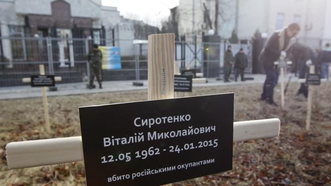 A cross with the name of a victim who was killed in the shelling of the government-held port of Mariupol by pro-Russian rebels on January 24, is pictured during a protest against Russia's actions in Donetsk region in front of Russian embassy in Kiev
