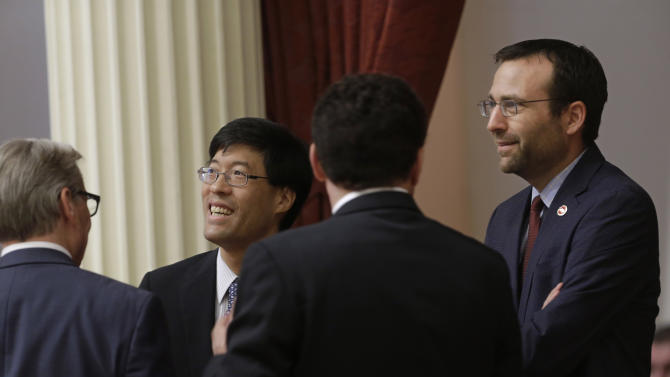 State Sen. Richard Pan, D-Sacramento, second from left, and Sen. Ben Allen, D-Santa Monica, right, smile after their measure requiring nearly all California school children to be vaccinated, was approved by the Senate, Monday, June 29, 2015, at the Capitol in Sacramento. The bill will go to the governor. Also seen are Sen. William Monning, D-Carmel, left, and Sen. Marty Block, D-San Diego, third from left. (AP Photo/Rich Pedroncelli)