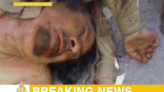 This image made available by the Al Jazeera television channel, claims to show former Libyan leader Moammer Gadhafi, after he was killed at an undisclosed location in Libya, Thursday Oct. 20, 2011. Libya's information minister said Moammar Gadhafi was killed Thursday when revolutionary forces overwhelmed his hometown, Sirte, the last major bastion of resistance two months after the regime fell. (AP Photo/Al Jazeera)