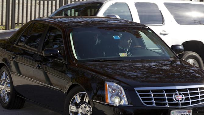A vehicle in a motorcade carrying former CIA Director David Petraeus leaves Capitol Hill in Washington, Friday, Nov. 16, 2012, after Petraeus testified before closed-door sessions of the House and Senate Intelligence Committees. (AP Photo/Jose Luis Magana)