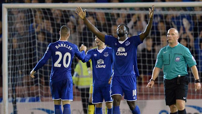 Everton's Romelu Lukaku (C) celebrates scoring a goal during their English League Cup 2nd round match against Barnsley, at the Oakwell Stadium in Barnsley, on August 26, 2015