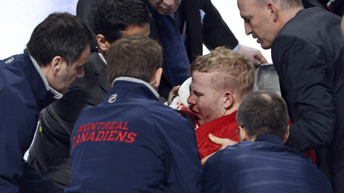 Montreal Canadiens center Lars Eller is placed onto a stretcher after being checked by Ottawa Senators defenseman Eric Gryba during the second period of Game 1 of an NHL hockey Stanley Cup playoffs first-round series in Montreal on Thursday, May 2, 2013. (AP Photo/The Canadian Press, Ryan Remiorz)