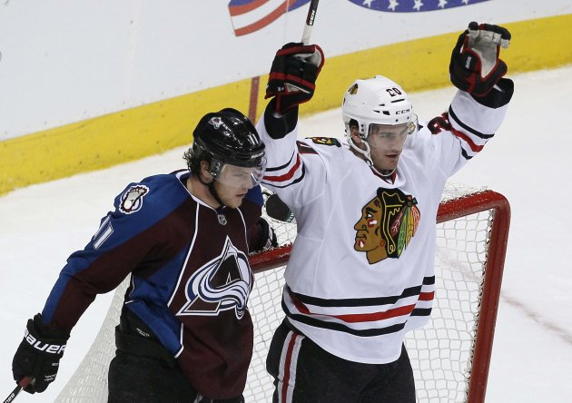 Chicago Blackhawks' Saad celebrates a goal beside Colorado Avalanche's McGinn in their NHL hockey game in Denver