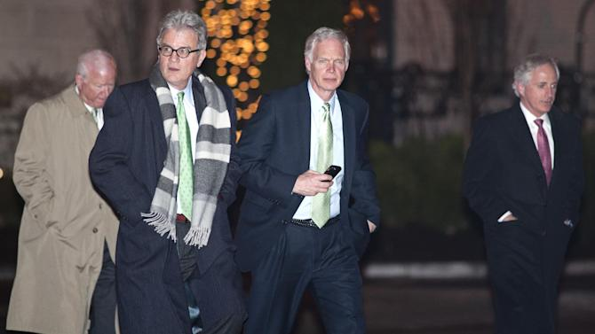 Sen. Saxby Chambliss, R-Ga., left, Sen. Tom Coburn, R-Ok., center left, Sen. Ron Johnson, R-Wisc., center right, and Sen. Bob Corker, R-Tenn., depart the Jefferson Hotel after a dinner meeting hosted by President Barack Obama for a few Republican Senators in Washington, Wednesday, March 6, 2013. Obama's efforts are aimed at jumpstarting budget talks and rallying support for his proposals on immigration and gun control. (AP Photo/Cliff Owen)