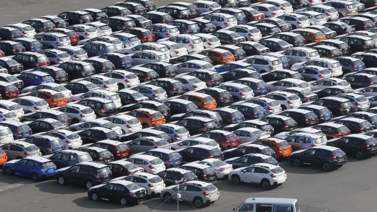 FILE - In this Dec. 20, 2012 photo, cars for export park at a port in Kawasaki, west of Tokyo.  Japan's industrial production picked up pace in December from the month before, in a sign the world's third-largest economy may be stabilizing thanks to stronger global demand and government spending. Increased output of large passenger cars and vehicle components and machinery for making semiconductors were the main factors helping to drive the improvement in manufacturing, the Ministry of Economy, Trade and Industry said Thursday, Jan. 31, 2013. It said industrial output rose a seasonally adjusted 2.5 percent from November.(AP Photo/Koji Sasahara, File)
