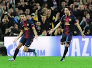 Barcelona's Pedro Rodriguez (L) celebrates with Jordi Alba after scoring during their Champions League match against PSG on April 10, 2013. The 71st-minute strike by Pedro allowed Barcelona to qualify for the semi-finals at the expense of PSG