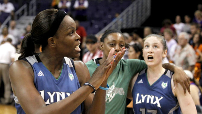 FILE - In this Sept. 25, 2011, file photo, Minnesota Lynx's Taj McWilliams-Franklin, left, Monica Wright, center, and Lindsay Whalen (13) celebrate the team's win over the Phoenix Mercury in a game during the WNBA basketball Western Conference finals in Phoenix. As the Lynx prepare to defend their title, every key player is back, including McWilliams-Franklin, who put off retirement for another season. (AP Photo/Ross D. Franklin, File)