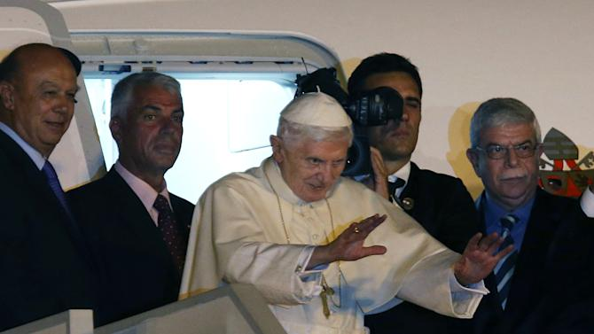 """Pope Benedict XVI waves as he boards the plane back to Rome, at Rafik Hariri International airport, in Beirut, Lebanon, Sunday Sept. 16, 2012. Pope Benedict XVI end his three days visit to Lebanon after he celebrated an open-air mass for tens of thousands of pilgrims from across the Middle East, saying Christians must do their part to end the """"grim trail of death and destruction"""" in the region. (AP Photo/Hussein Malla)"""
