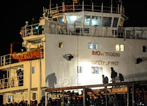 Immigrants wait early on Decembre 31, 2014 aboard the …
