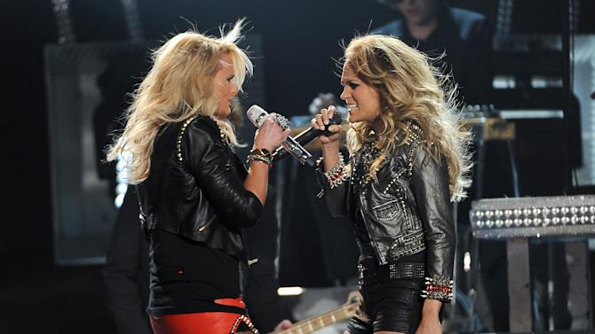 Miranda Lambert, left, and Carrie Underwood perform on stage at the Billboard Music Awards at the MGM Grand Garden Arena on Sunday, May 18, 2014, in Las Vegas. (Photo by Chris Pizzello/Invision/AP)