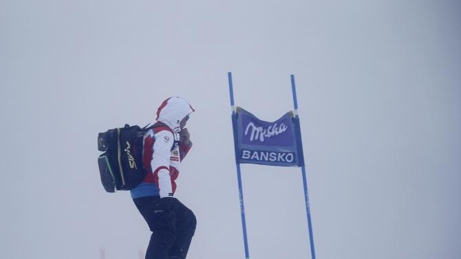 An official skis down the slope after the women's Super G event of the Alpine Skiing World Cup was cancelled due to fog in Bansko