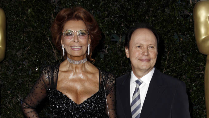 Actress Sophia Loren, left, and Billy Crystal arrive at The Academy of Motion Picture Arts and Sciences Tribute honoring her in Beverly Hills, Calif., Wednesday, May 4, 2011.  Loren's life and career will be celebrated by friends and colleagues Wednesday. (AP Photo/Matt Sayles)