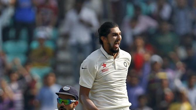 India's Sharma and captain Kohli celebrate after the dismissal of South AfricaÕs Villiers during the third day of their third test cricket match in Nagpur
