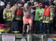 Ernie Ross, 79, welcomes the new year as he prepares to leap from the government wharf into the frigid North Atlantic in the annual New Year's Day polar bear swim in Herring Cove, N.S. on Wednesday, Jan. 1, 2014. THE CANADIAN PRESS/Andrew Vaughan