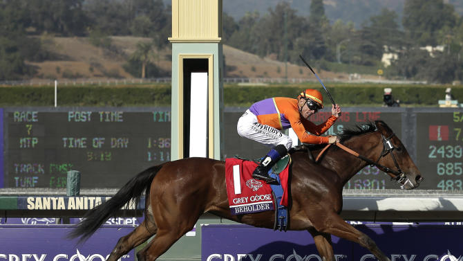 Beholder with jockey Garrett Gomez atop, crosses the finish line to win the Juvenile Fillies horse race at the Breeders' Cup, Friday, Nov. 2, 2012, Arcadia, Calif. (AP Photo/Gregory Bull)