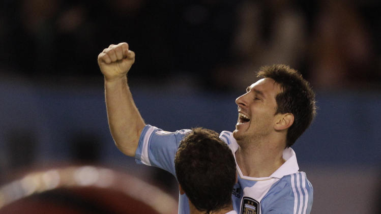 Argentina's Gonzalo Higuain, back to camera, celebrates with teammate Argentina's Lionel Messi after scoring during a 2014 World Cup qualifying soccer game against Chile in Buenos Aires, Argentina, Friday, Oct. 7, 2011. (AP Photo/Eduardo Di Baia)