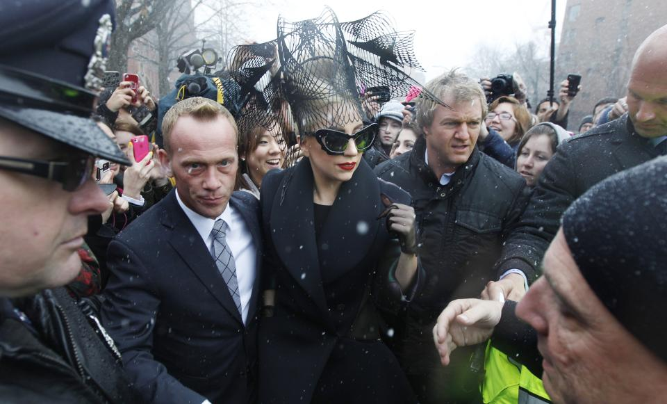 "Lady Gaga is surrounded by security as she walks through the campus prior to an event at Harvard University in Cambridge, Mass. Wednesday Feb. 29, 2012. Gaga launched her ""Born this Way"" foundation at Harvard. (AP Photo/Charles Krupa)"