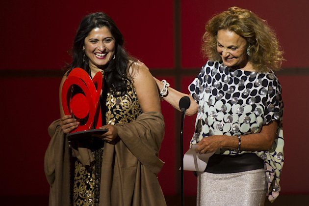 Award recipient Sharmeen Obaid-Chinoy, left, and Diane Von Furstenberg appear onstage at the Glamour Women of the Year Awards on Monday, Nov. 12, 2012 in New York. (Photo by Charles Sykes/Invision/AP)