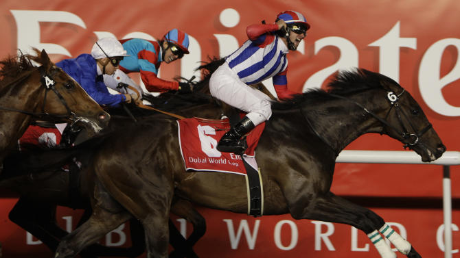 Victorie Pisa from Japan ridden by Mirco Demuro crosses the finish line of the $ 10,000,000 Dubai World Cup race, the world's richest horse race ,  followed by 2nd place Transcend from Japan and 3rd placed Monterosso from Great Britain at the Meydan in Dubai, United Arab Emirates, Saturday March 26, 2011. (AP Photo/Kamran Jebreili)