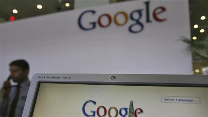 File photo of a security personnel answering a call at the reception counter of the Google office in the southern Indian city of Hyderabad